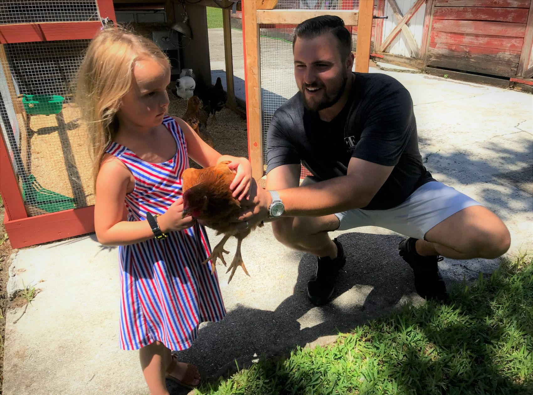 girl holding chicken on a farm tour at the farm experience palmetto fl